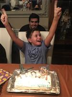 11 years old!  Holding up 2 1's!